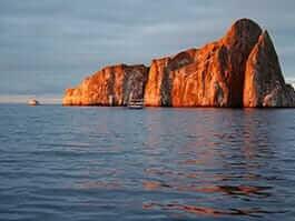 san cristobal galapagos kicker rock dive site illuminated at sunset