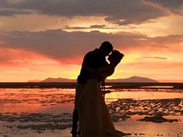 south america honeymoon destinations - a romantic couple of the beach at sunset