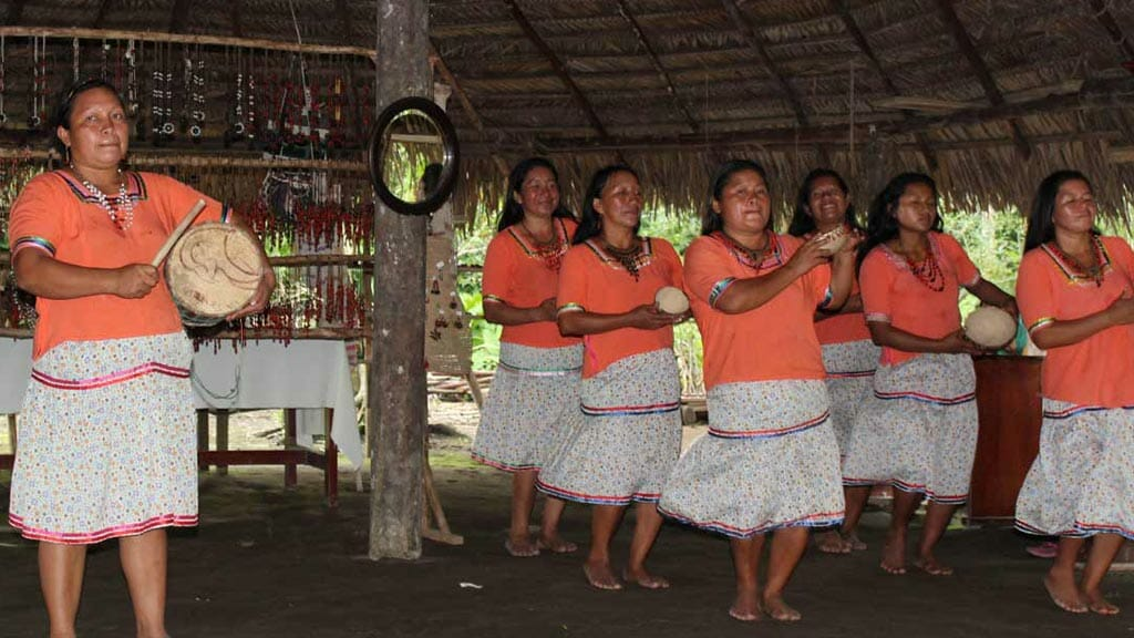 locals dancing in an amazon jungle hut