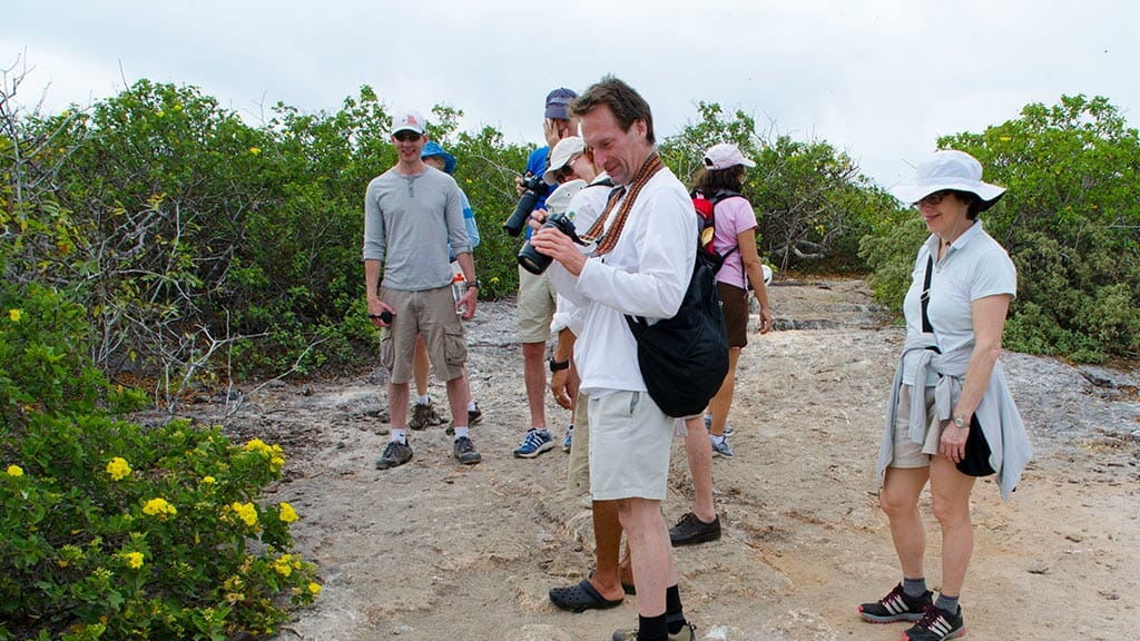 tourists with cameras at the galapagos islands