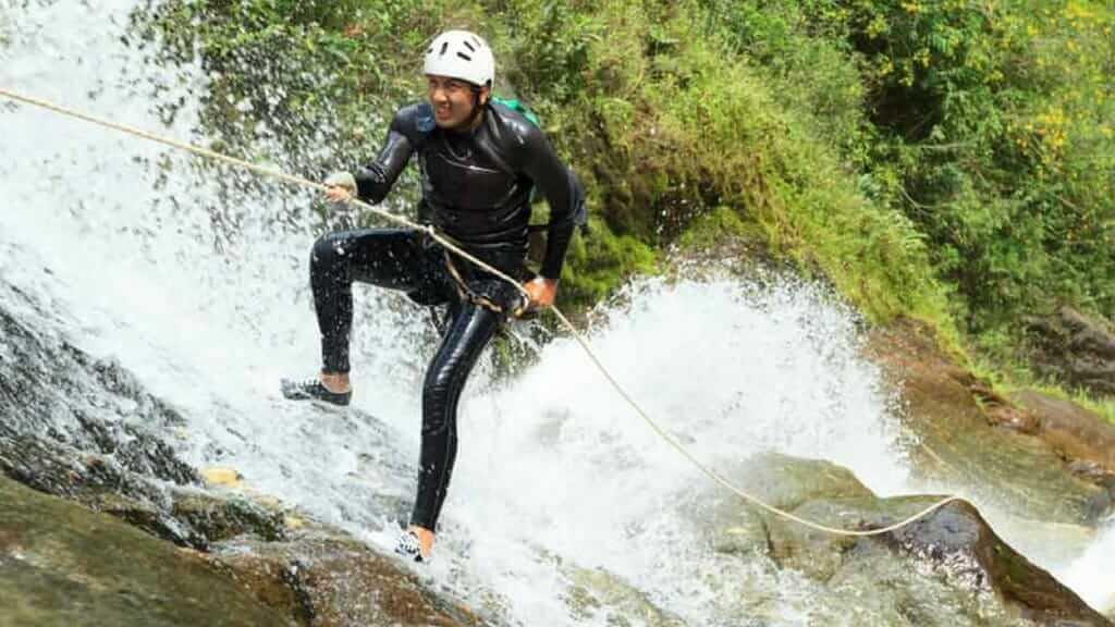 canyoning down a waterfall banos ecuador
