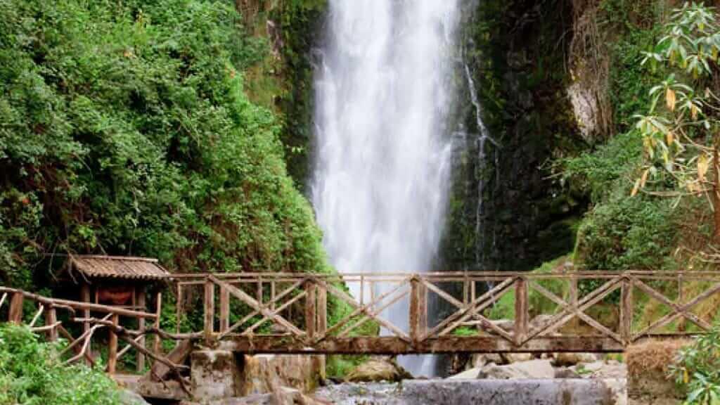 lookout bridge in front of taxopamba waterfall ecuador