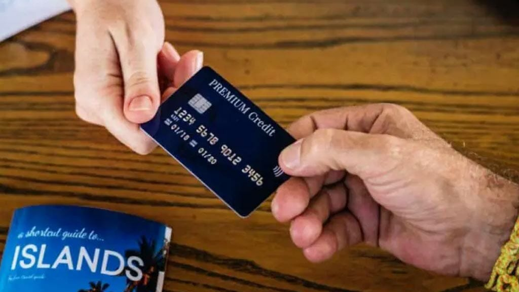 credit card use in ecuador - a clients hands over his credit card to business