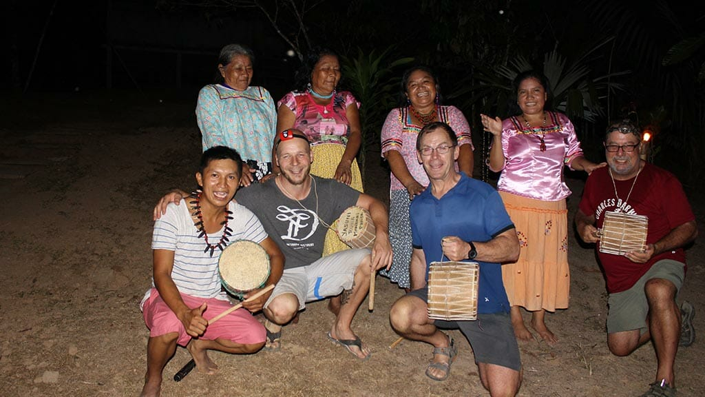 tourists join locals in cultural music night in the ecuador amazon jungle
