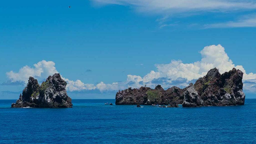 devils crown crater emerging from the blue ocean at floreana galapagos