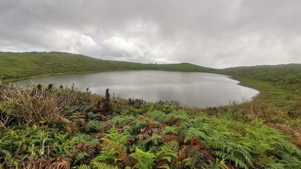 el junco lake shrouded in mist on san cristobal highlands galapagos