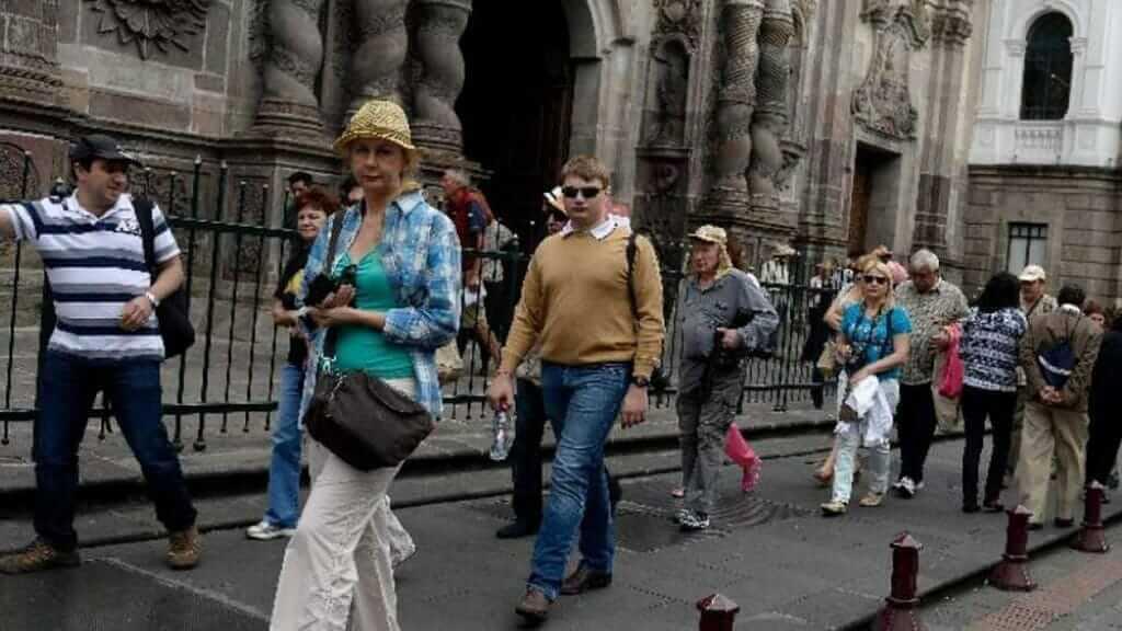 a tourists group exploring quito historic center ecuador