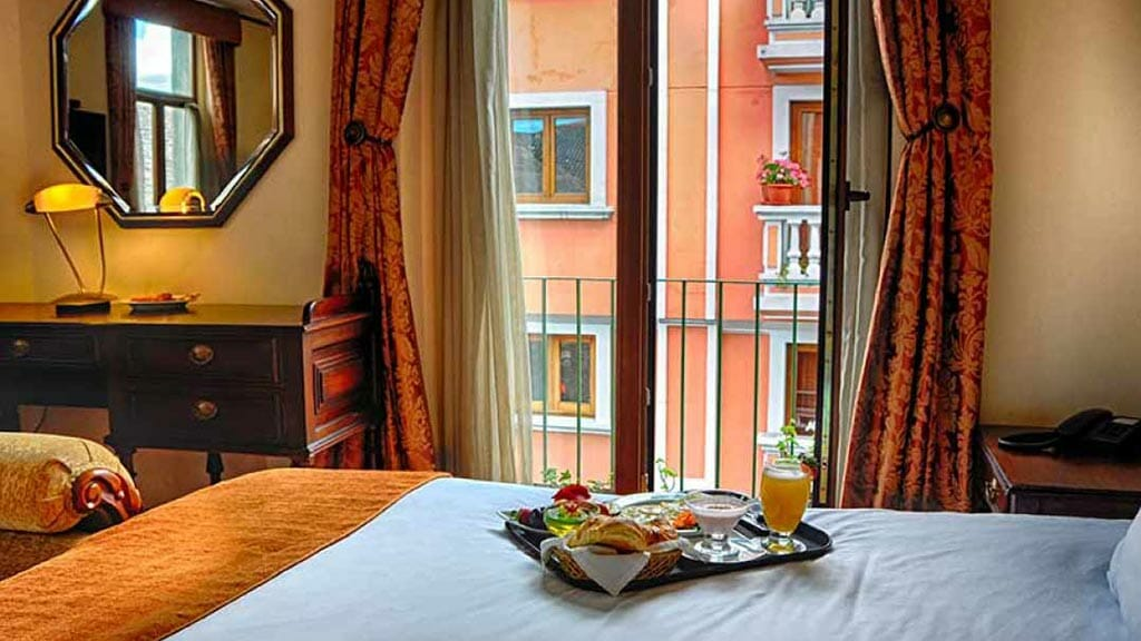 breakfast served in bed at colonial style hotel real audiencia in quito ecuador