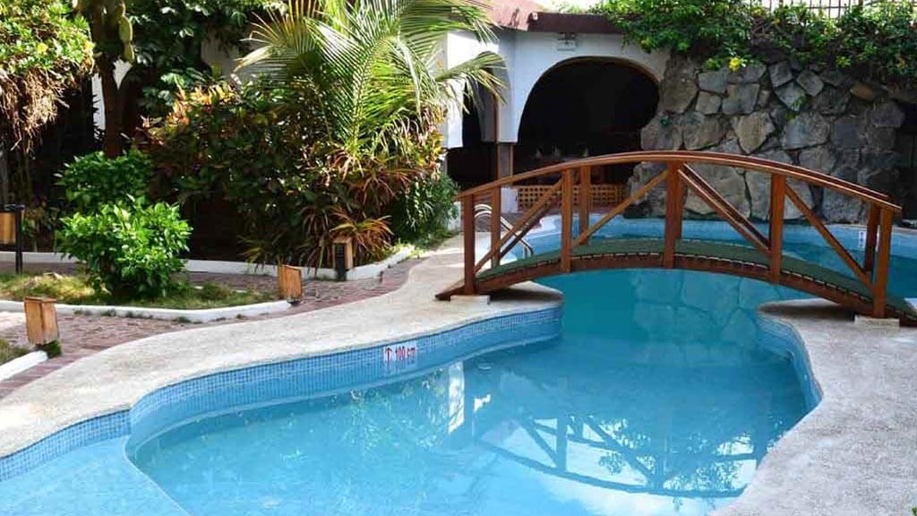bridge over swimming pool at hotel silberstain galapagos