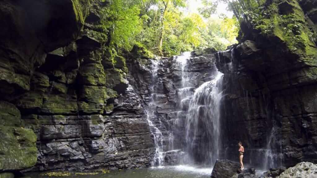 bather at las latas waterfall ecuador mishualli