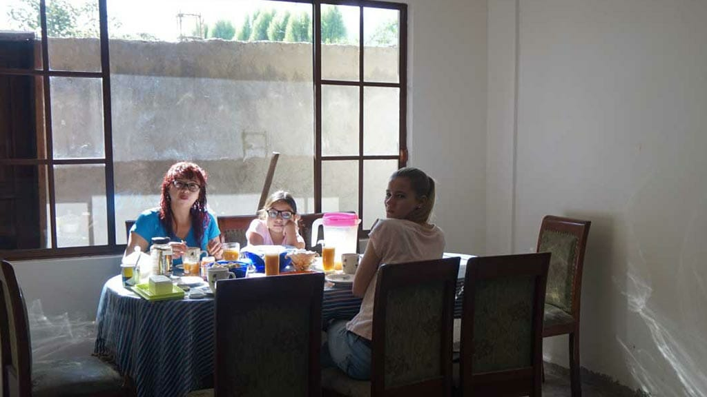 eating with a local indigenous family homestay ecuador