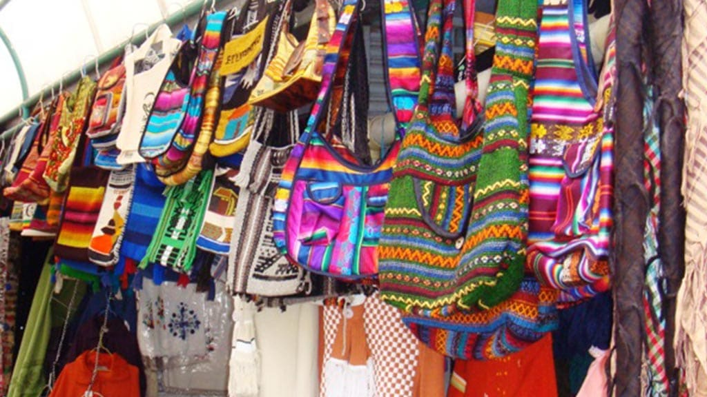 colorful bags for sale at quito artesanal handicraft market