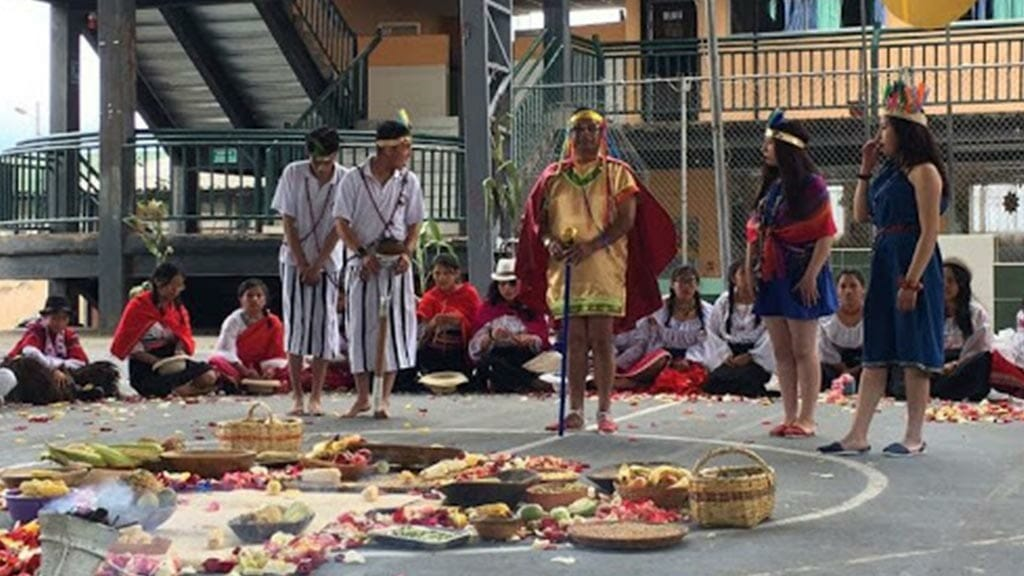 fruit and harvest offering laid out on floor at ecuador's pawkar raymi festival