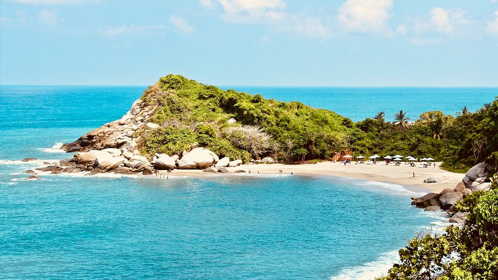 beautiful white sand beach and turquoise waters at tayrona colombia
