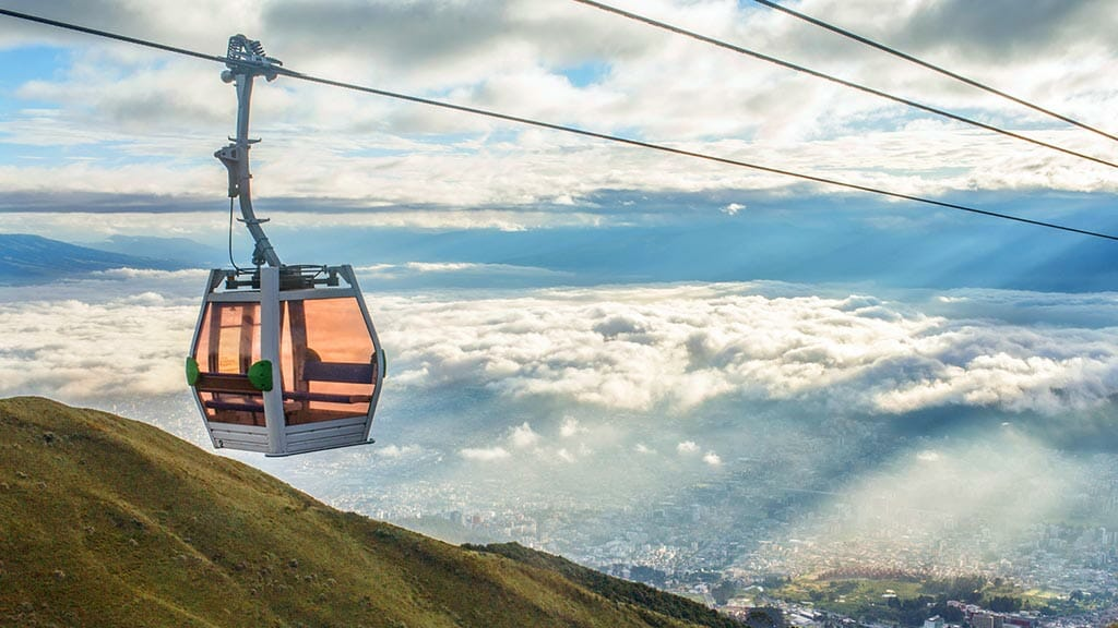 a quito teleferico cable car high above the clouds and city of quito