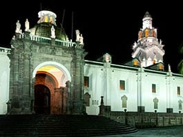 entrance to quito cathedral lit up at night