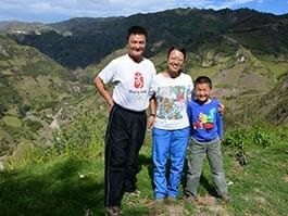 family photo with green andes mountain backdrop