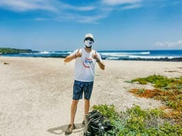 a happy gringo tourist on the beach at the galapagos islands