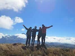 ecuador hikers celebrate reaching the summit