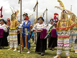 people dressed in colorful costumes for pawkar raymi celebrations in otavalo ecuador