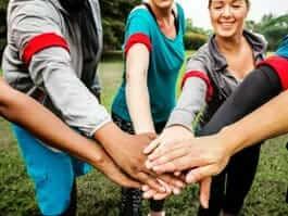 hands together team work with ecuador volunteers