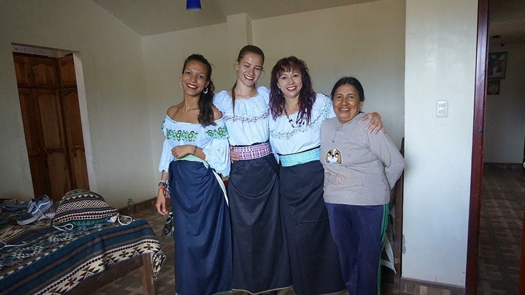 3 tourists dressed up in local indian dresses to celebrate ecuador inti raymi