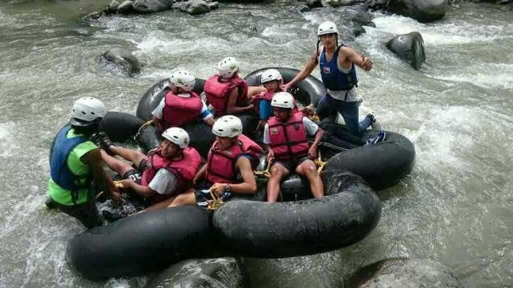tourists river tubing in banos ecuador