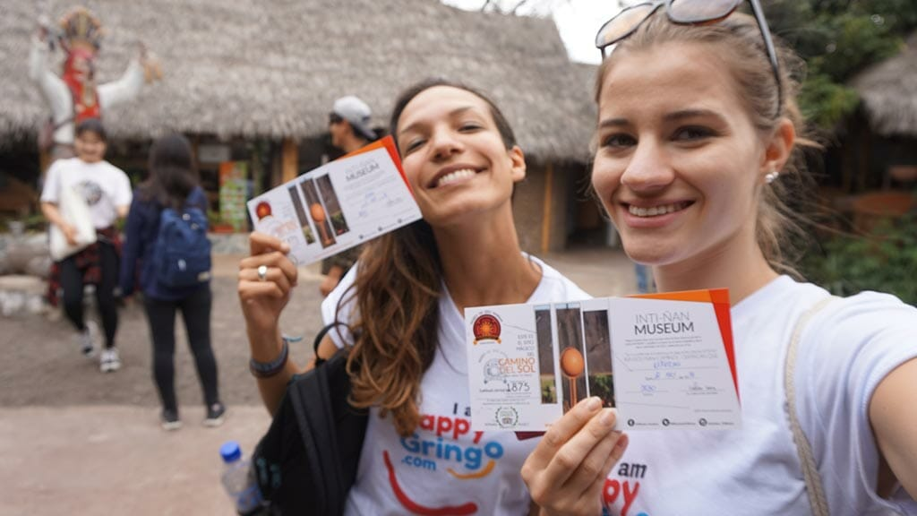 two happy gringo tourists with entry tickets for inti ñan equator museum quito ecuador