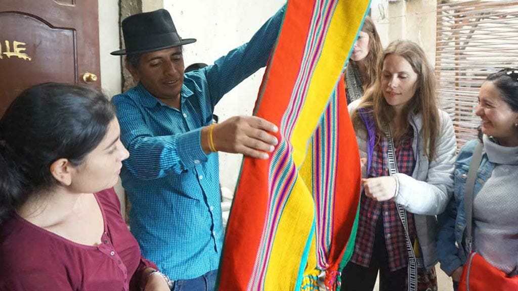 volunteer in ecuador with an indigenous family