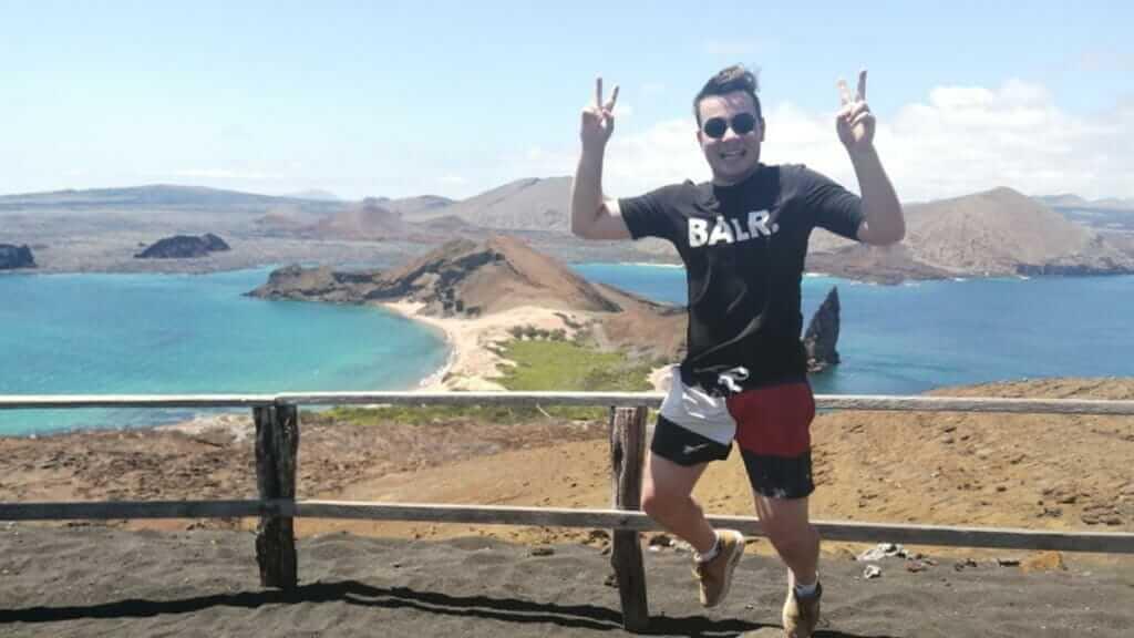 happy gringo tourist posing at bartolome galapagos