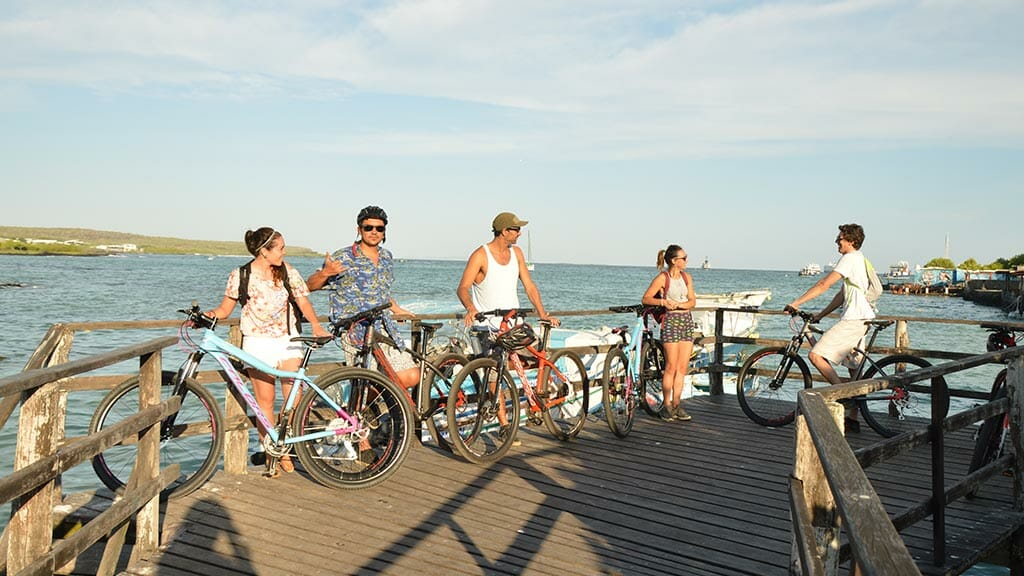 mountain bikers on wooden dock at the galapagos islands
