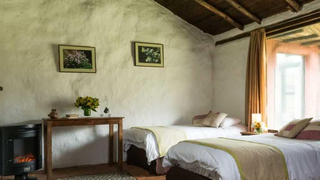 cosy bedroom at hosteria chilcabamba cotopaxi ecuador