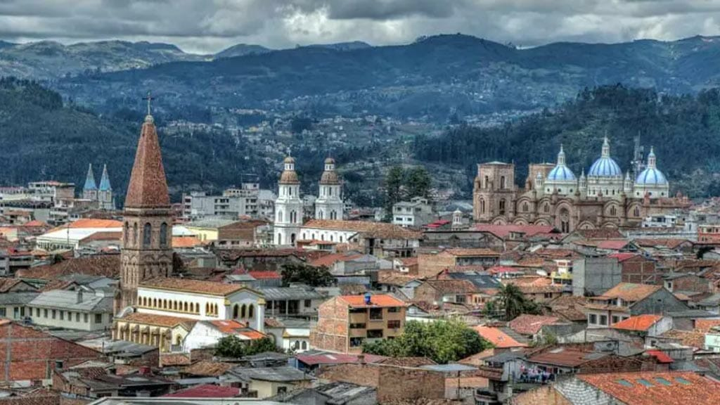 cuenca historic center landscape with church towers and mountains in ecuador