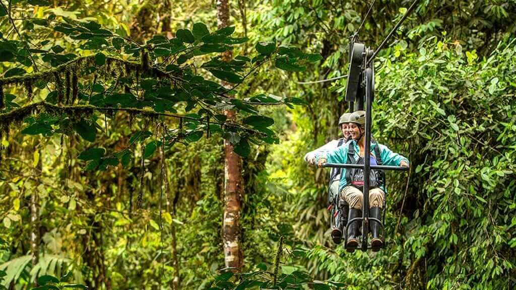 ecuador cloud forest romance couple on honeymoon using the mashpi lodge skybike