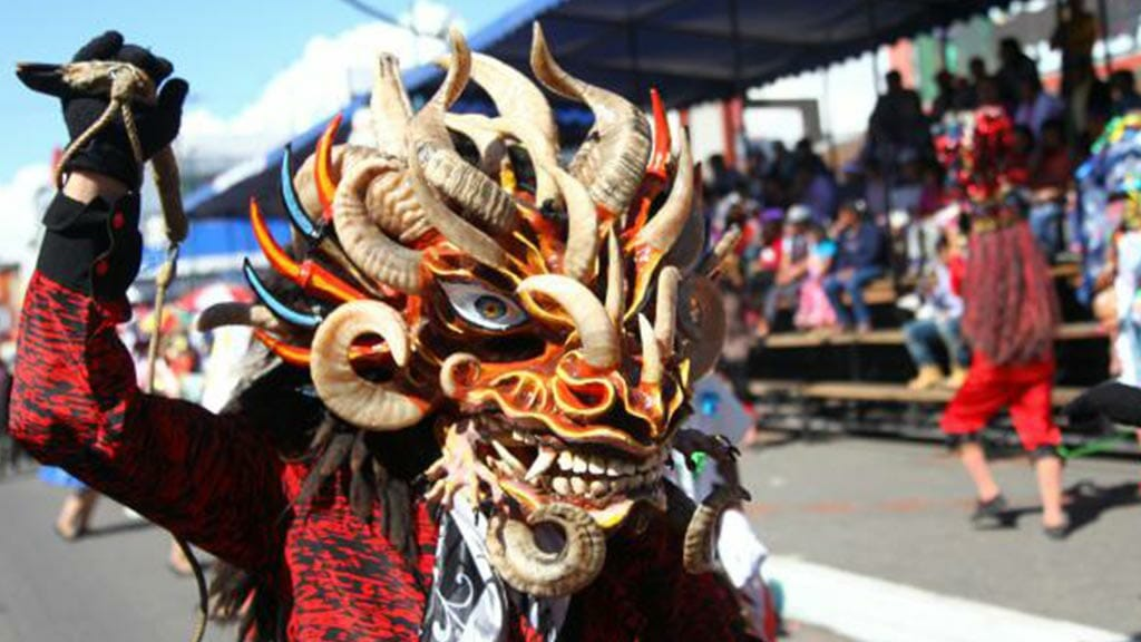 scary costume at the diablada festival pillaro ecuador