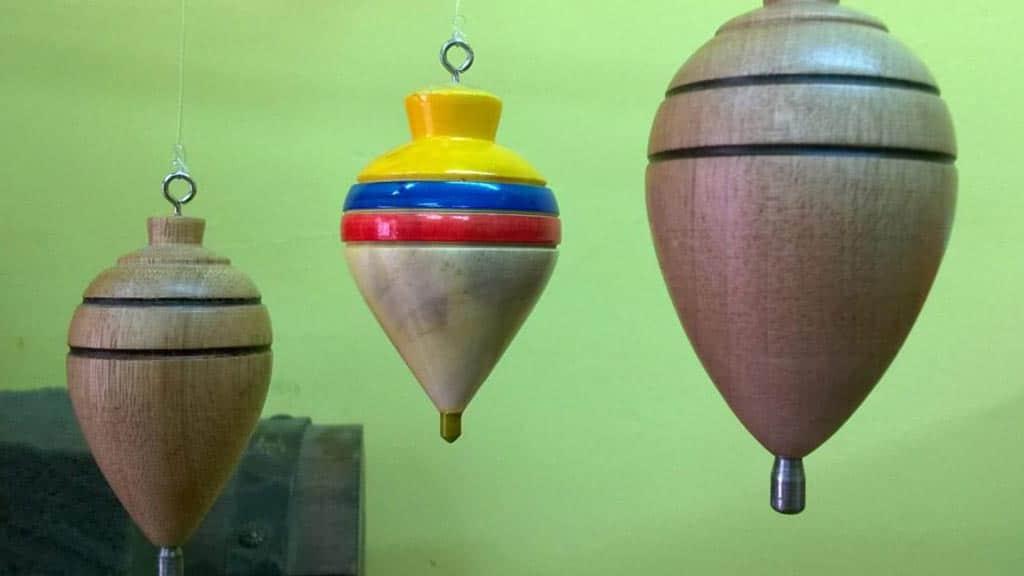 traditional spinning top trompo souvenirs for sale at la ronda quito ecuador