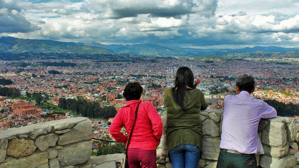 tourists enjoy the cuenca city view from turi lookout