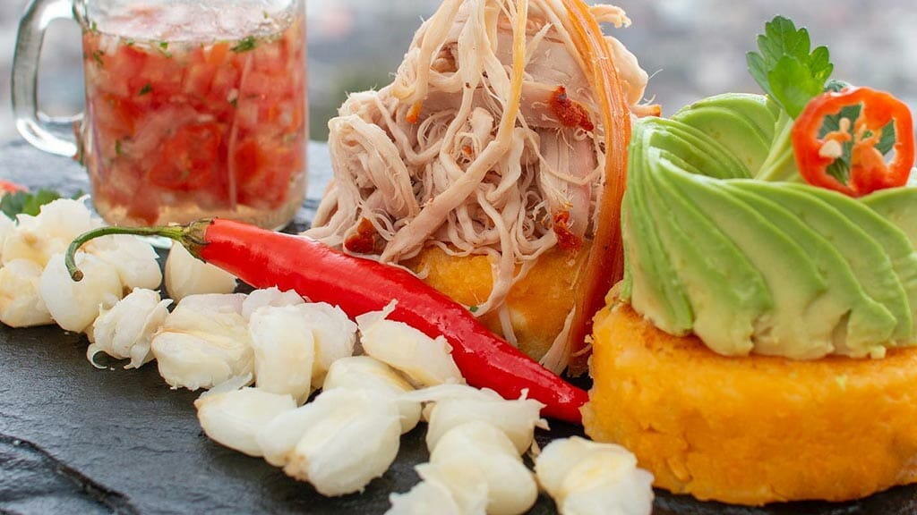 traditional food of roast pork and llapingachos at pims restaurant quito