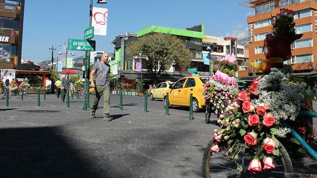 tourist walking across the plaza foch new town quito