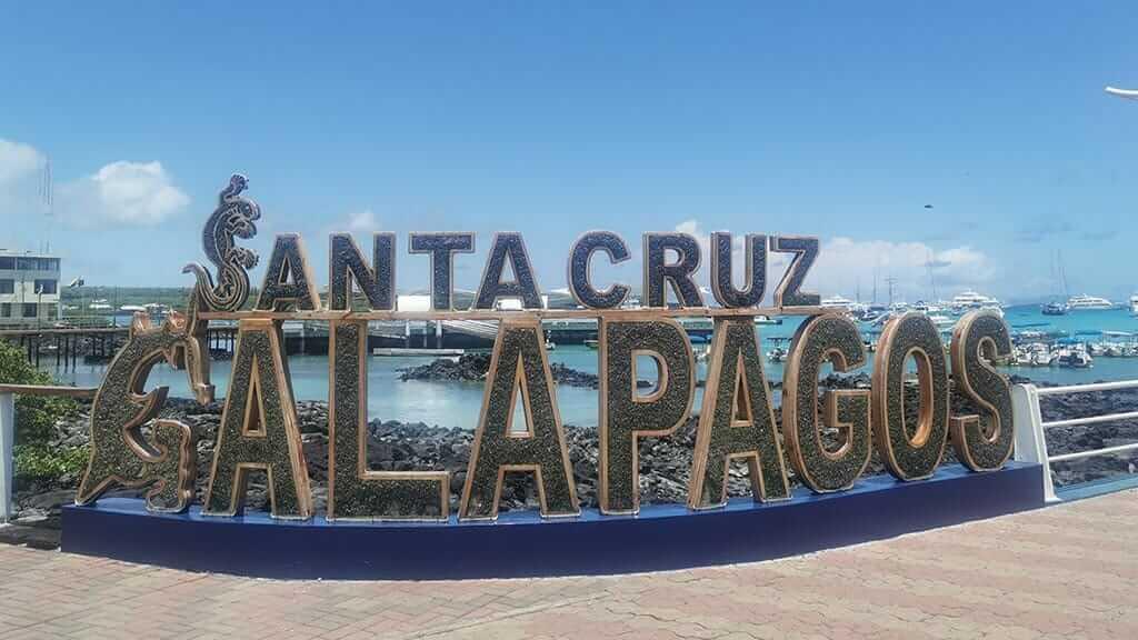 puerto ayora galapagos sign at the pier