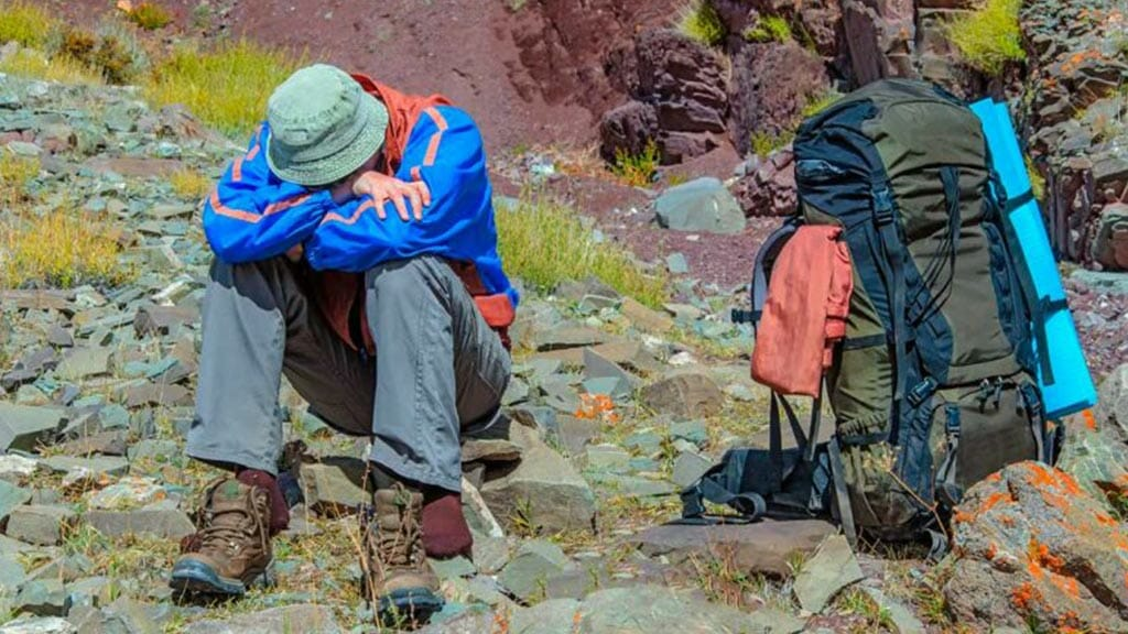 tourist treker with soroche altitude sickness in quito ecuador
