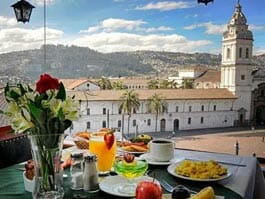 breakfast with a view over santa domingo plaza from quito hotel