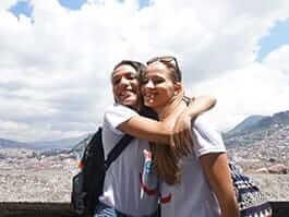 two happy gringo tourists hug in quito ecuador