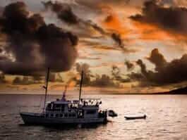 galapagos yacht cruising at sunset