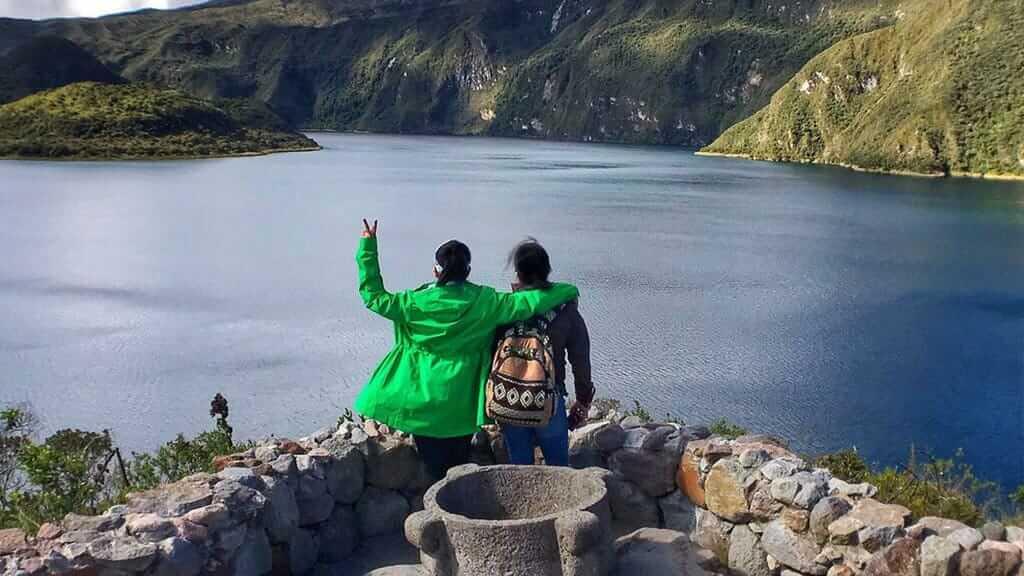 tourist couple enjoy the landscape of cuicocha lake
