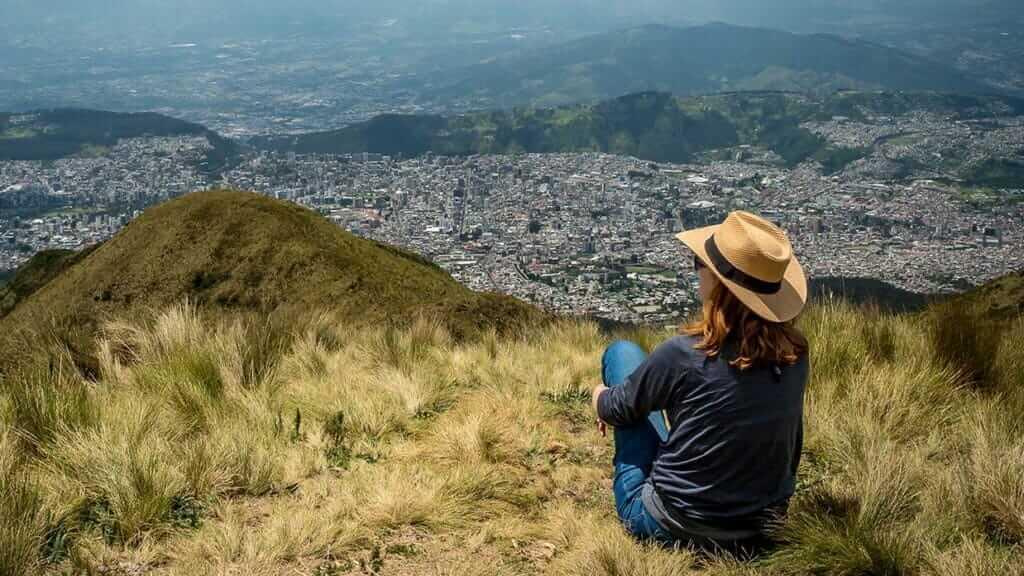 tourist in hat above quito ecuador avoiding altitude sickness