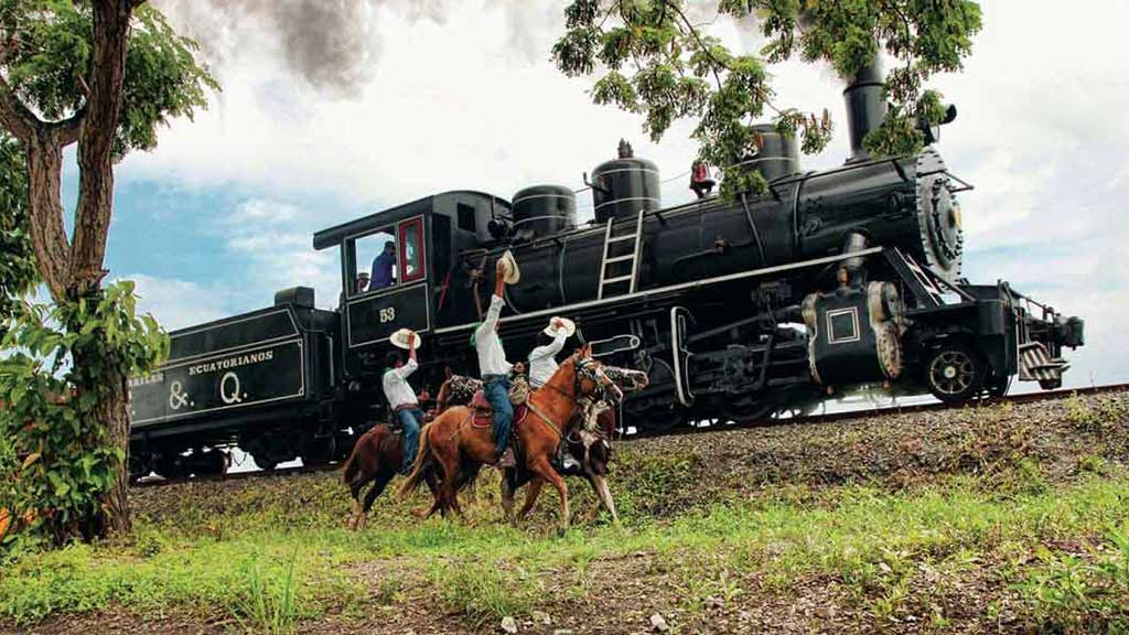 local cowboys salute a passing train in ecuador