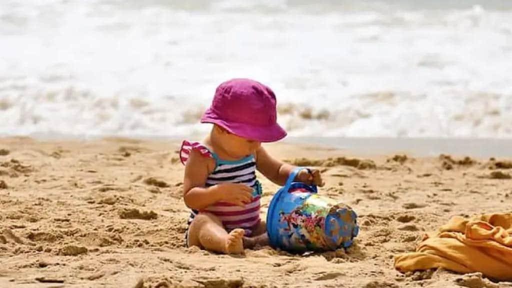 baby enjoying the beach in the galapagos islands