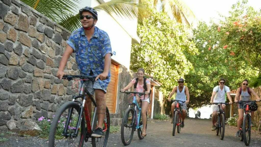 tourists cycling in the galapagos islands tour