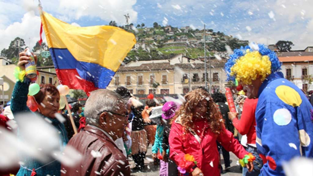spray foam and fancy dress at ecuador carnival in quito